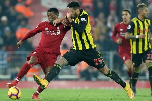 Liverpool's Georginio Wijnaldum and Watford's Etienne Capoue battle for the ball during the Premier League match at Anfield