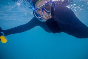 Catherine Galaska snorkelling at the Great Barrier Reef, Australia