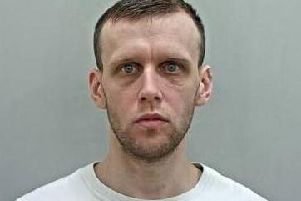 Dean Guest, 31, is wanted by police in Lancashire regarding a number of matters.