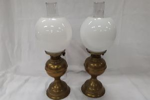 This pair of oil lamps are in good working order and on sale for 45