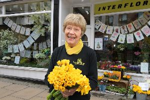 Margaret Mason outside her florists
