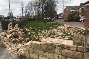 The smashed wall after being hit by a car