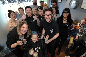 Dexter Ormerod with the staff at 468 Barbers in Lostock Hall