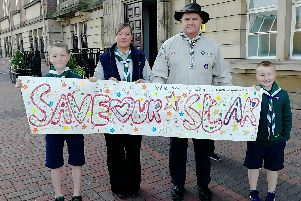 Alistair Lawless, Natalie Lawless (beaver scout leader), Ian Walls (group scout leader) and Leo Lawless outside County Hall