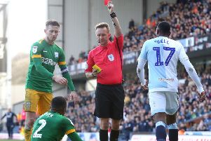 Preston right-back Darnell Fisher is sent off by referee Oliver Langford against Blackburn in March