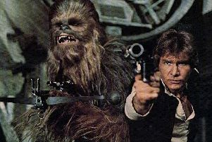 Peter Mayhew, Chewbacca, and Harrison Ford, Han Solo