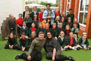 School teacher Kate Levett and her fiance Danny are having 30 children from her school sing at their wedding