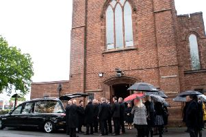 Hearse arrives at Our Lady & St Gerards RC Church in Lostock Hall for the funeral of Graham Walton