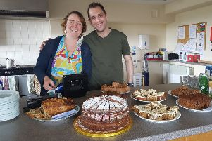 Global Link manager Gisela Renolds with the first Syrian refugee to settle in Lancaster.