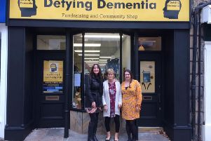 Linda Warrington, Dr Penny Foulds and Linda's daughter Lucy at the Defying Dementia shop in Lancaster.