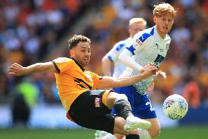 Ben Pringle is challenged by Newport's Robbie Wilmott at Wembley