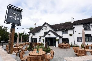 Outside the pub, which has reverted to its 16th Century name from The Eagle and Child, has been redecorated and new signs, lighting and planters installed.