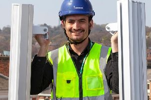 Neil Knighton, communications manager for Internexus, shows off the wireless transmitters that will provide Preston's ultra-fast internet