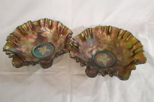 With fluted edges and leaf designs these are good examples of carnival glass
