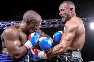 Damian Chambers, right, in action during a previous bout