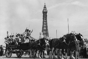 A group of bathers getting a lift on a dray pulled by four of London Brewery's Clydesdale Shire horses in Blackpool for the Royal Show of 1953