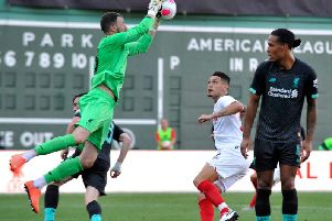 Andrew Lonergan takes a cross playing for Liverpool against Sevilla in Boston