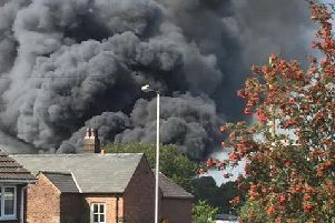 Smoke is seen billowing from the commercial unit in Eccleston
