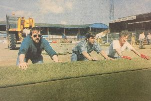 Workmen roll up and remove Preston North Ends plastic pitch at Deepdale in summer 1994