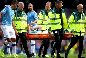 Aymeric Laporte is carried off during City's win against Brighton