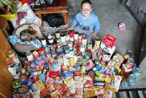 Joshua Blackwell (8), who attends Farington Moss St Paul's CE Primary School, filled sevenfull crates with hygiene products, non-perishable food and warm clothing. He spent nearly every day for six weeks collecting the items, whichwere donated to the Salvation Army in Preston.