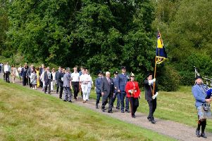 Relatives of the airmen join in a memorial procession, along with dignitaries and members of the armed forces. Picture by Chris Silk