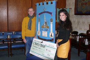Tony Lowe, the current master of Chorley Freemasons, presents his lodges Baby Beat donation to Roya Armstrong, fundraising co-ordinator for the Lancashire Teaching Hospitals Charity