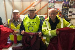 Charlie Embley, Jim Paterson and Peter Buckley, members of Lancashire Rotary Clubs, sorting coats for the Wrap Up Lancashire campaign.