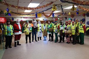 Volunteers at Gregson Green Community Centre's SantaSleighCollection last year.