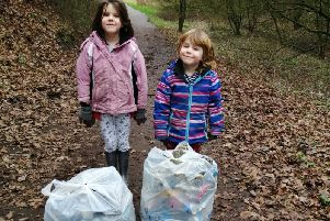 Amanda Goode's daughter and son with the bags of rubbish collected by the family.