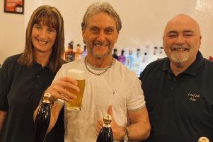 Rachel and Ray McLaughlin with motorcycling star Carl Fogarty at Lostock Ale. Photo credit: Claire Sutton.