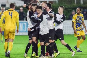 Matt Dudley, second from left, is mobbed by his team-mates after scoring the winner  against Radcliffe