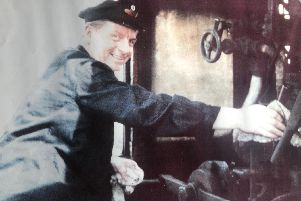 Vinny - who worked in the railway industry all his working life - driving a steam train.