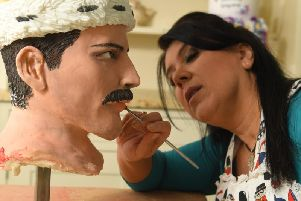 Rosie creates a look-alike Freddie Mercury out of cake
