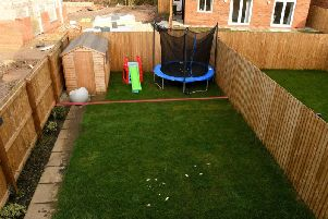 Pam Unsworth's back garden in Cottam with the red line showing where the new fence will be.