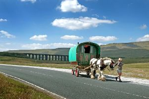 A romany caravan passes Ribblehead Viaduct on the way to the Appleby Horse Fair last year. This years event has been cancelled due to the coronavirus pandemic