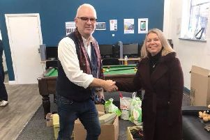 Jeff Marsh, Foxton Centre CEO, receiving a donation to the Preston homeless shelter.
