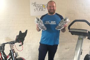 Michael Brennand with new shoes he had bought himself to run for Rosemere Cancer Foundation in the London Marathon,