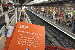 Leaflets are handed out to commuters at Preston station. Photo: Great North Rail Project