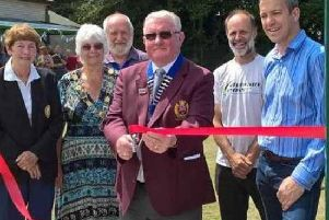 Cutting the ribbon at the opening of the new Crown Green Bowling lawn
