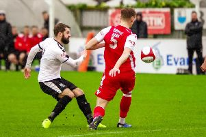 Alistair Waddecar in action against Hednesford Town'Photo: Ruth Hornby