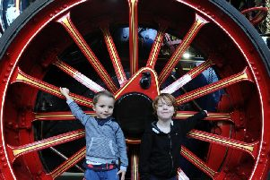 Aaron Dorset aged 5 and Torrin Baker aged 4 in the giant wheels of a steam engine. Picture by Paul Heyes.