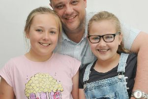 Mike Swanson with his daughters