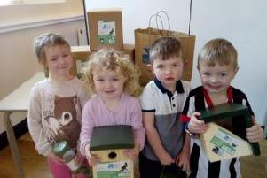 Youngsters at Charnock Richard Preschool handed over bird boxes, feeders and bird food to the Orchard Gardens renovation project.