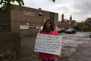 Joanne Griffiths protesting outside Longton's polling station, claiming the Tory Government has let down her son Ben.