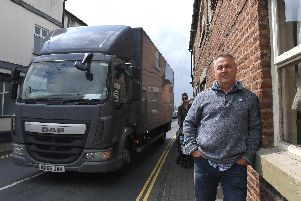Nathan Pattison on Fox Lane as a lorry goes past