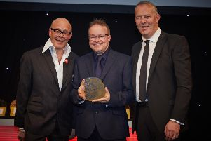 Leyland's Worden Academy business manager Mark Reed collected his TES Award from comedian Harry Hill at a glittering gala event in London'a Park Lane