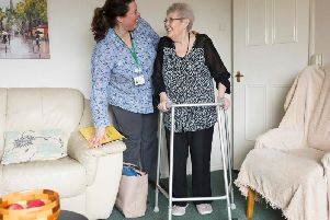 Dorothy Smith at home with Anne-Marie Crook, a St Catherine's Hospice support assistant 'www.chrisbullphotographer.com