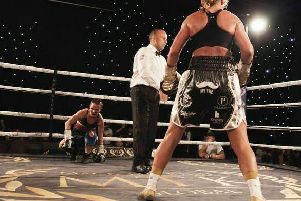 Lisa Whiteside stands over  Evgeniya Zablotskaya after putting her on the canvas on Friday night.   PHOTO: Karen Priestley