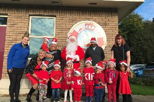 Eric Wright's nursery manager Joanne Pierpoint (left) and nursery nurse Emma Reibbitt (far right) with children who attend Eric Wright Groups on-site nursery. Also supporting the dash are, from the left, Rosemere Cancer Foundations Rebecca Arestidou, Eric Wright Groups Suzanne Taylor and Alan Taylor, who is helping to organise the Cheeky Santa Dash
